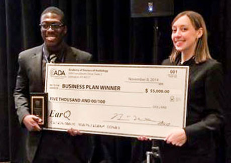 Audiology Business Plan Competition Winner with Check
