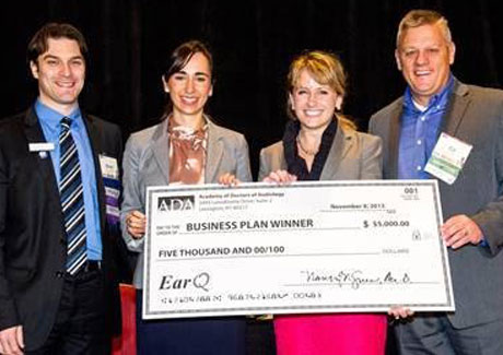 Business Plan Competition Winner with Check