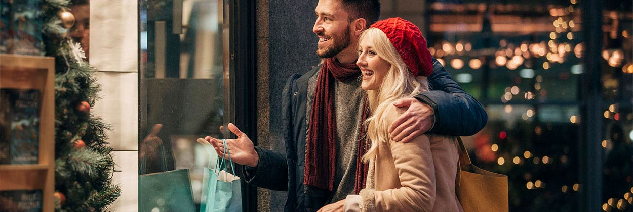 Couple shopping while listening to festive songs