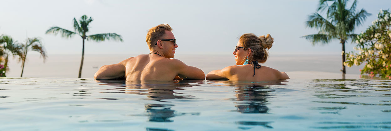 Mature couple in infinity pool