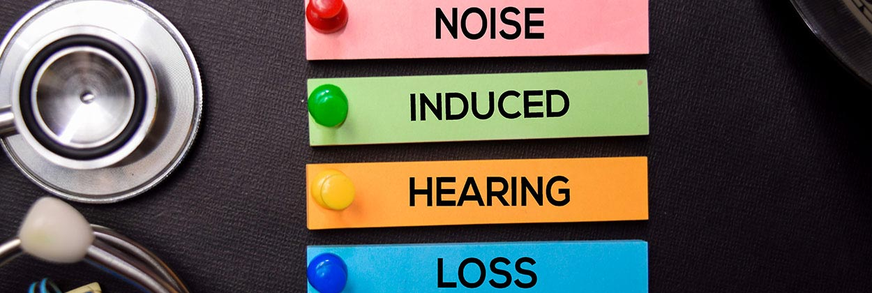 Noise induced hearing loss sticky notes on audiologist desk
